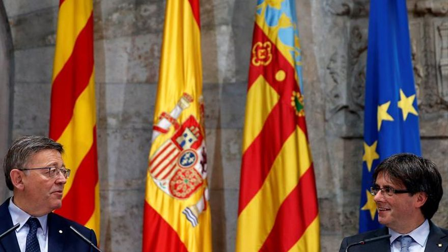 Puig y Puigdemont acusan al Gobierno de castigar al eje mediterráneo