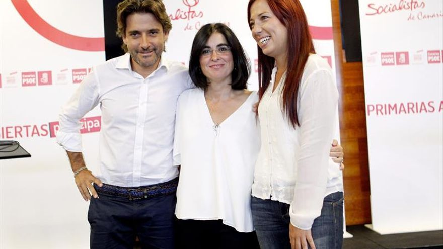 Gustavo Matos, Carolina Darias y Patricia Hernández antes de comenzar el debate. EFE/Cristóbal García