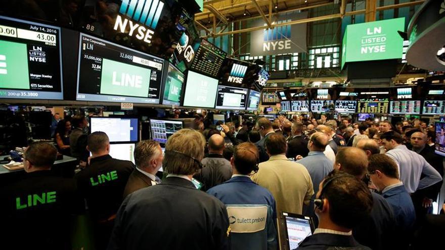 Wall Street amplía las ganancias y el Dow Jones sube un 0,73 % a media sesión