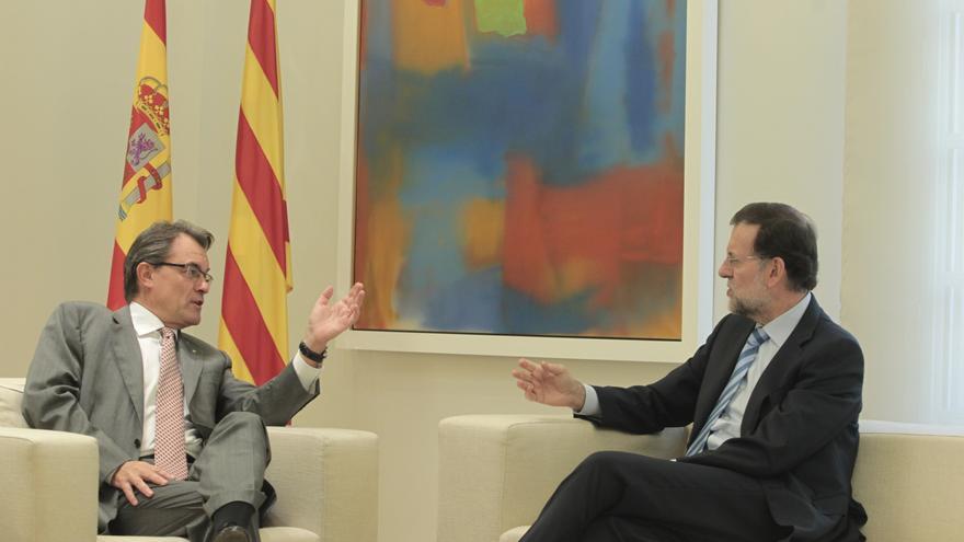 """Rajoy advierte a Mas que el pacto fiscal no es """"compatible"""" con la Constitución y le pide evitar la inestabilidad"""