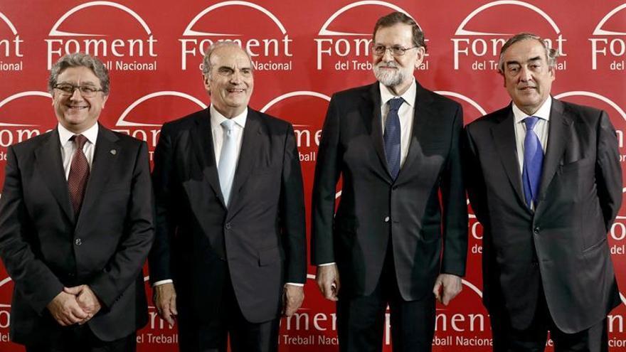 Rajoy anima a empresarios catalanes a restaurar juntos la confianza perdida