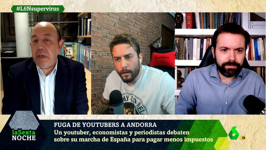 Gonzalo Bernardos (izq) debate con Roma Gallardo (centro)